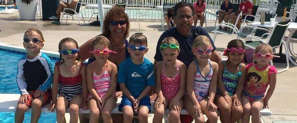 coach lori and robert with kids